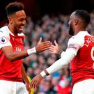 Alexandre Lacazette (right) celebrates with Pierre-Emerick Aubameyan after scoring Arsenal's first goal. Photo credit: Nick Potts/PA Wire