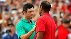 Rory McIlroy congratulates Tiger Woods after winning the Tour Championship at East Lake Golf Club. Photo: Christopher Hanewinckel-USA TODAY Sports