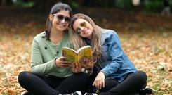 Shades at the ready: Izabela Ferreira (27), left, and Maressa Figueiredo (27), both from Rio de Janeiro, enjoy the good weather in St Stephen's Green in Dublin. Photo: Damien Eagers