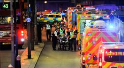 Terror: Police and members of the emergency services attend to a victim injured in the deadly attack on London Bridge on June 3, 2017. Photo: AFP/Getty Images