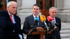 Minister for Finance and Public Expenditure and Reform, Paschal Donohoe along with Minister for Education, Richard Bruton and Minister of State for Disability Issues, Finian McGrath, hold a press conference on the new pay agreement on the new entrants' salary-scale issues. Photo: Garrett White / Collins Photo Agency