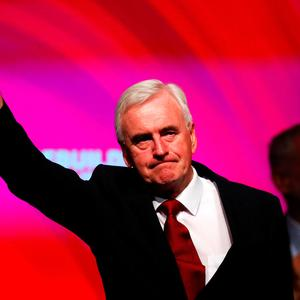 The Labour Party's shadow Chancellor of the Exchequer John McDonnell waves after speaking at the party's conference in Liverpool. Photo: Reuters