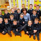 Worry: Principal Nuala Mhic Gabhann, of Urbleshanny National School, Scotstown, Co Monaghan, with some pupils from first class. Photo: Lorraine Teevan