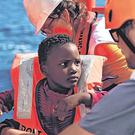 Lives at risk: The NGOs operating the Aquarius will now no longer be able to rescue migrants like this child from boats north of the Libyan coast. Photo: Getty