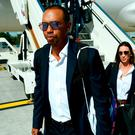 Tiger Woods (C) arrives at Paris Charles de Gaulle airport in Roissy yesterday