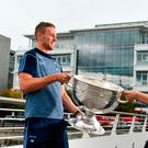 Paul Mannion with Dublin ladies' Lyndsey Davey and the Sam Maguire at AIG's Dublin offices. Photo by Sam Barnes/Sportsfile