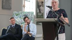 Clash: Housing Minister Eoghan Murphy (centre) listens to junior minister Catherine Byrne speak in Inchicore in July