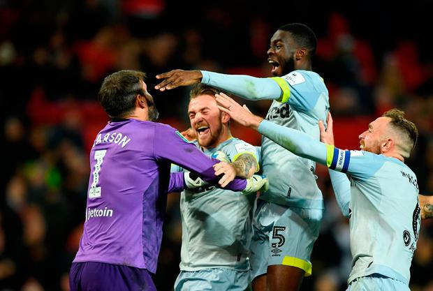 Scott Carson of Derby County celebrates with teammates after he saves Manchester United's eighth penalty from Phil Jones during a penalty shoot out. Photo: Gareth Copley/Getty Images