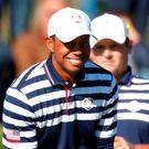 Team USA's Tiger Woods and Patrick Reed during practice. REUTERS/Charles Platiau
