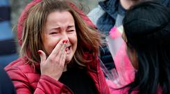 Tears: A mourner is overcome with grief at the funeral of Ingrida Maciokaite in Dundalk. Photos: Steve Humphreys