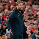 Liverpool's German manager Jurgen Klopp reacts during the English League Cup third round football match between Liverpool and Chelsea at Anfield in Liverpool, north west England on September 26, 2018. (Photo by Paul ELLIS / AFP)