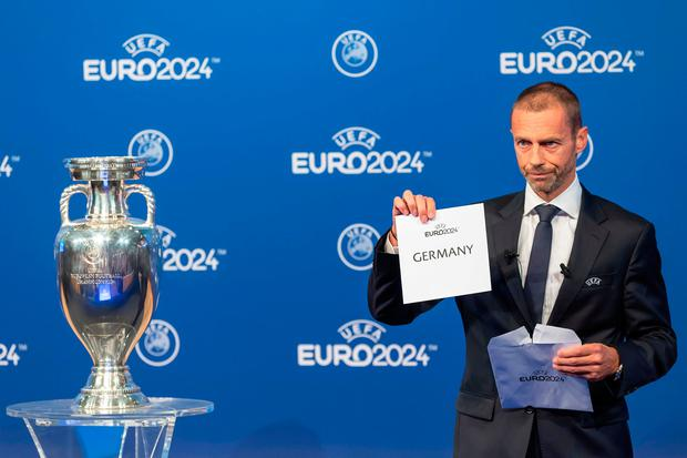 UEFA president Aleksander Ceferin, announces that Germany will stage the 2024 European Championships, during the Euro 2024 Host Announcement Ceremony, at the UEFA Executive Committee at the UEFA Headquarters, in Nyon, Switzerland, Thursday, September 27, 2018. (Martial Trezzini/Keystone via AP)