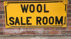 A wool sale room sign is pictured outside an auction, sampling and storage and distribution centre in Yennora, Sydney, Australia September 20, 2018. Picture taken September 20, 2018. REUTERS/Jonathan Barrett