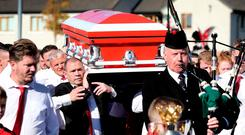Tragedy: Kyle Hooper's remains are carried from the Church of the Incarnation in Tallaght. Photo: Steve Humphreys