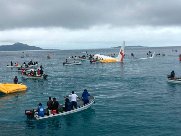 People are evacuated from an Air Niugini plane crashed in the waters in Weno, Chuuk, Micronesia, September 28, 2018 in this picture obtained from social media. James Yaingeluo/via REUTERS