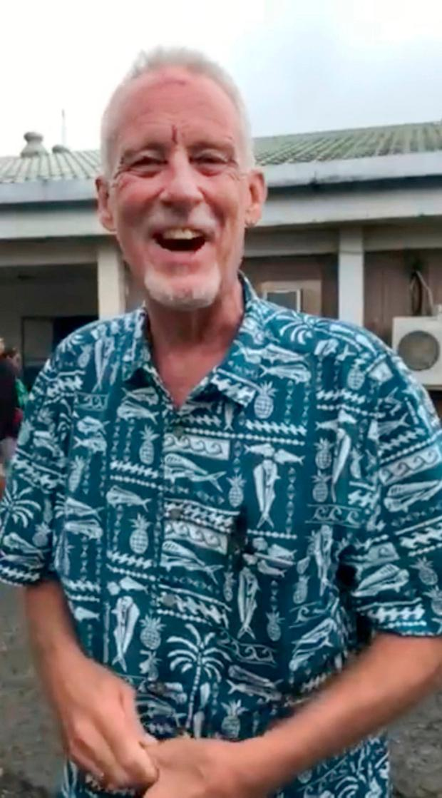In this image made from video, Bill Jaynes, managing editor of the Kaselehlie Press in FSM, or Micronesia, explains his experience as a passenger on a plane that crashed in the waters off the runway on Chuuk Island, in the Federated States of Micronesia, Friday, Sept. 28, 2018. (Matthew Colson via AP)