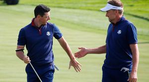 Team Europe's Rory McIlroy and Ian Poulter