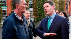 Finance Minister Paschal Donohoe (right) speaks with local resident Geoffrey Fox following a press conference in Smithfield, Dublin. Credit: Brian Lawless/PA Wire