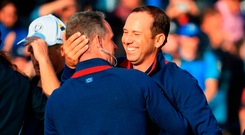 Sergio Garcia is embraced by vice-captain Luke Donaldo after Europe's victory in yesterday's foursomes. Photo: Andrew Redington/Getty Images)