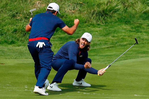 Team Europe's Francesco Molinari and Tommy Fleetwood celebrate during the Fourballs yesterday. Photo: Paul Childs/Reuters