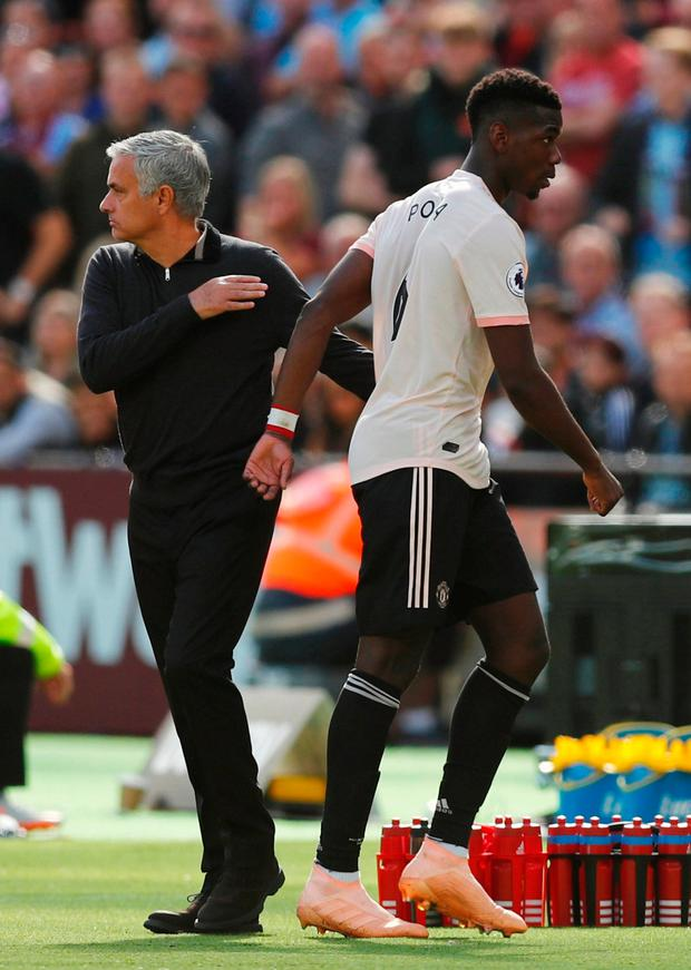 Manchester United's Paul Pogba with manager Jose Mourinho after being substituted off