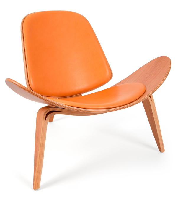 """'50s style chair, €850: """"This Hans Wegner-style armchair will look immense next to a Spiced Honey wall,"""" says Carol-Anne Leyden; cadesign.ie"""