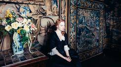 Actress Emma Stone in a scene from The Favourite, one of Element Pictures' latest movies