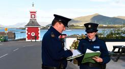 Gardai conduct door-to-door inquiries at Knightstown on Valentia Island in Co Kerry last Monday in the case of Baby John, whose body was found on White Strand, Cahersiveen, in 1984. Picture: Don Macmonagle