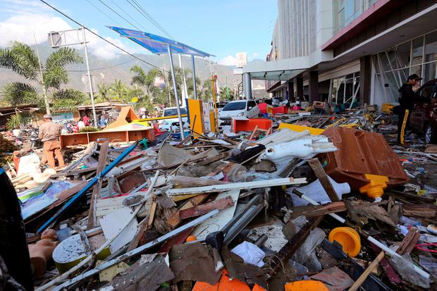 A pile of debris is seen at a shopping mall damaged following earthquakes and tsunami in Palu, Central Sulawesi, Indonesia