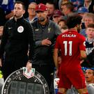 Liverpool's Mohamed Salah is substituted and shakes hands with manager Jurgen Klopp