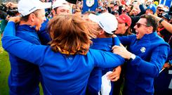 francesco Molinari of Europe celebrates winning The Ryder Cup with members of the European team