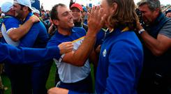 Europe's Francesco Molinari and Tommy Fleetwood celebrate