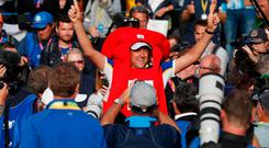 Team Europe's Ian Poulter celebrates in fancy dress after winning the Ryder Cup