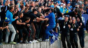 Golf - 2018 Ryder Cup at Le Golf National - Guyancourt, France - September 30, 2018. Team Europe's Rory McIlroy celebrates with spectators after winning the Ryder Cup REUTERS/Carl Recine