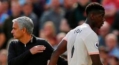 Paul Pogba walks past Jose Mourinho after being substituted during Saturday's defeat by West Ham. Photo: Reuters