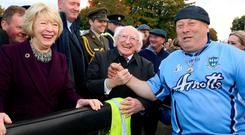 Michael D Higgins shaking hands with Christopher Gunling in Ballinasloe. Photo: Hany Marzouk