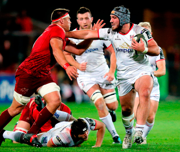 Ulster's Tom O'Toole battles against CJ Stander of Munster at Thomond Park. Photo: John Dickson/Sportsfile