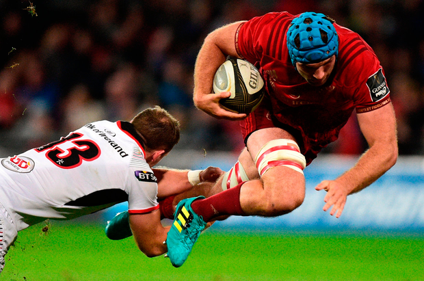 Munster's Tadhg Beirne is tackled by Darren Cave of Ulster. Photo: Matt Browne/Sportsfile