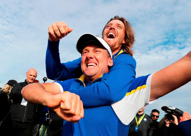Tommy Fleetwood and Ian Poulter celebrate after Europe's victory in the Ryder Cup. Photo: Richard Heathcote/Getty Images