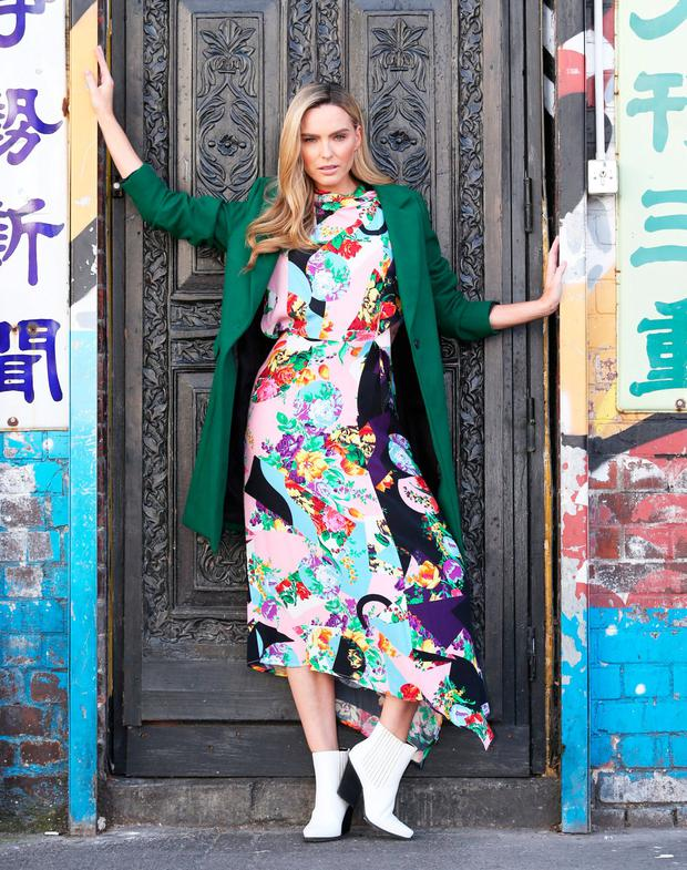 Sarah Morrissey wears spliced floral print dress, €68, Topshop, green coat, €44.99, New Look and white ankle boots, €50, Schuh. Photo: Leon Farrell