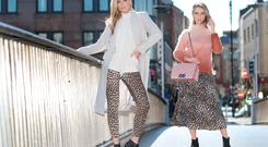 Models Sarah Morrissey and Grace O'Mahony photographed on Dublin's Millennium Bridge in a shoot for Jervis Shopping Centre. Photo: Leon Farrell