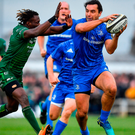 Leinster's James Lowe escapes the tackle of Connacht's Niyi Adeolokun. Photo: Brendan Moran/Sportsfile