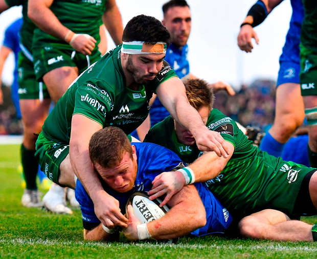 Leinster's Seán Cronin goes over to score his side's second try despite the efforts of Paul Boyle, left, and Kieran Marmion of Connacht. Photo: Brendan Moran/Sportsfile