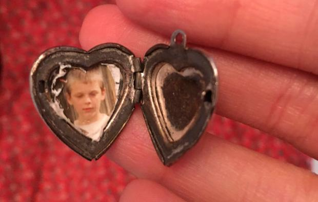 A woman who found a silver locket in a charity shop dress is looking to reunite it with its owner