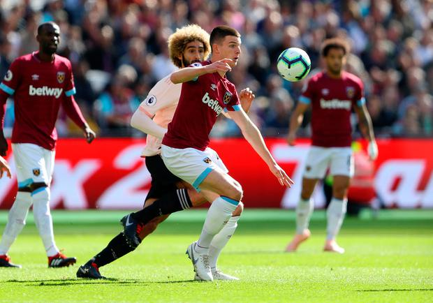 Declan Rice of West Ham United competes for the ball with Marouane Fellaini