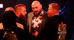 Tyson Fury of England reacts during a face off as during a press conference ahead of the match between Tyson Fury and Deontay Wilder in London