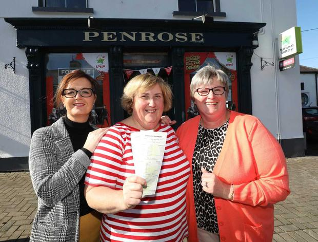 Anne Penrose, owner of Penrose's Store in Ballynacargy celebrates after she sells a €1 million Lotto Plus 1 top prize