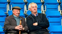 Davie Gordon and Lar Halley keep an eye on the cattle prices in Kilkenny Mart. Photo Roger Jones.