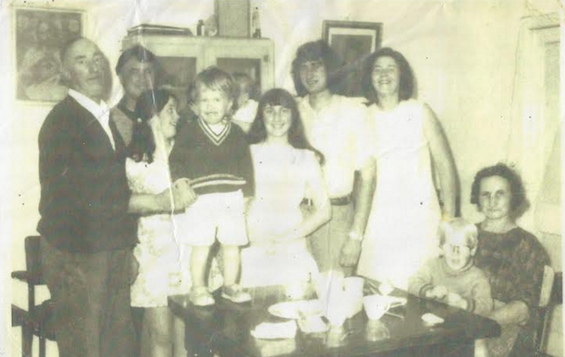 A family photo that features Anthony O'Reilly (second left), his sister Geraldine (standing on the table)