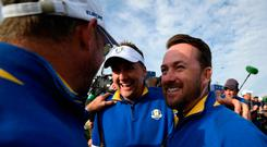 Europe's Ian Poulter (C) and vice-captain Graeme McDowell
